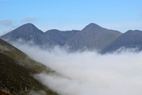 Carrauntoohil and Beenkeragh above the clouds, seen from Cnoc na dTarbh, MacGillycuddy's Reeks, County Kerry