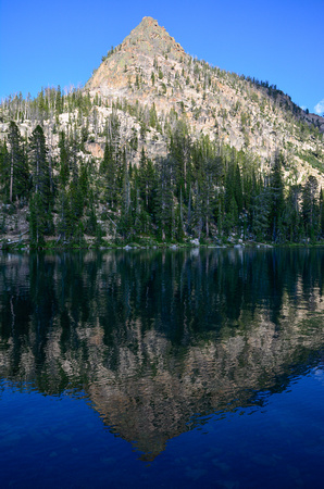 Peak 9510 reflected in Upper Baron Lake, Sawtooth Wilderness