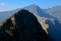 Y Lliwedd's main summit from its east peak, with Snowdon in the distance, Snowdonia National Park
